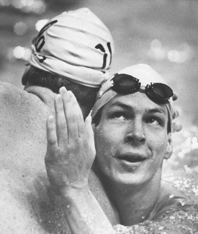©1990's  college swimmer after victory.