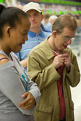 Group of day service users with learning disability shopping at the supermarket,
