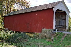 06 October 2013:   The Phillips Covered Bridge crosses Big Pond Creek on County Road South 420 West at County Road West 40 North southeast of Montezuma in Parke County. This single span Multiple King Post Truss structure has a length of 43 feet, or 61 feet including the 9-foot overhang at each end, is 16 feet wide and 14 feet high. Built in 1909 by Joseph A. Britton, though no historical marker is present, it was listed on the National Register of Historic Places in 1978.<br /> <br /> Parke County Indiana is the site of the Indiana Covered Bridge Festival every October<br /> <br /> This image was produced in part utilizing High Dynamic Range (HDR) processes.  It should not be used editorially without being listed as an illustration or with a disclaimer.  It may or may not be an accurate representation of the scene as originally photographed and the finished image is the creation of the photographer.