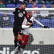 Carlos Ruiz, D.C.United, (left), wins a header from Jamison Olave, New York Red Bulls, in action during the New York Red Bulls V D.C. United, Major League Soccer regular season match at Red Bull Arena, Harrison, New Jersey. USA. 16th March 2013. Photo Tim Clayton