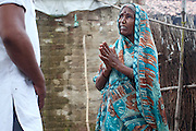 Prema, 60, the mother of Neelam, 16, is expressing suffering and struggles to Mangla Prasad, 34, the activist of PVCHR who helped the family after Neelam's sexual abuse, in Rajbhar village, located around 20 kilometres away from Varanasi, in Uttar Pradesh, India. Neelam was raped when she was 13 years old. After walking to a local shop on the main road neighbouring her village, she was forcibly picked up by two men. While one of them was raping her in the bushes, the other watched out. After some time, she managed to free herself and run away, hiding under a bridge in cold dirty water for several hours. When she returned home in the morning, the family was too afraid to go to the police, but activist Mangla Parsad, 34, from PVCHR, convinced the family to take the right action. The police initially insulted and threatened the family for bringing the facts up, but filed the official case (FIR) nevertheless. The rape was not mentioned in the file due to an inaccurate and superficial medical record that did not, in fact, mention it. Because of social shame facing by victims of rape in India, the family agreed to wed Neelam to an older man, with help of an agent. After the marriage, her husband raped her again for a whole month before she decided to return home with her family. Neelam's father works in the metal industry in Mumbai and manages to send around 2-3000 INR every month. He only visits the family once in a year. Neelam goes to school and she is studying in 11th Class Standard. She is interested in doing BA in Arts after completing her high school 12th final year.