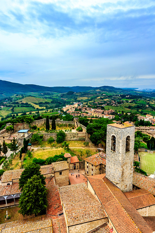 A bell tower and La Rocca fortress in San Gimignano in Tuscany, Italy. Florentine troops built this fortress as an act of domination and attested to the people of San Gimignano's submission to the Grand Duchy of Tuscany, controlled by the Florentine families.