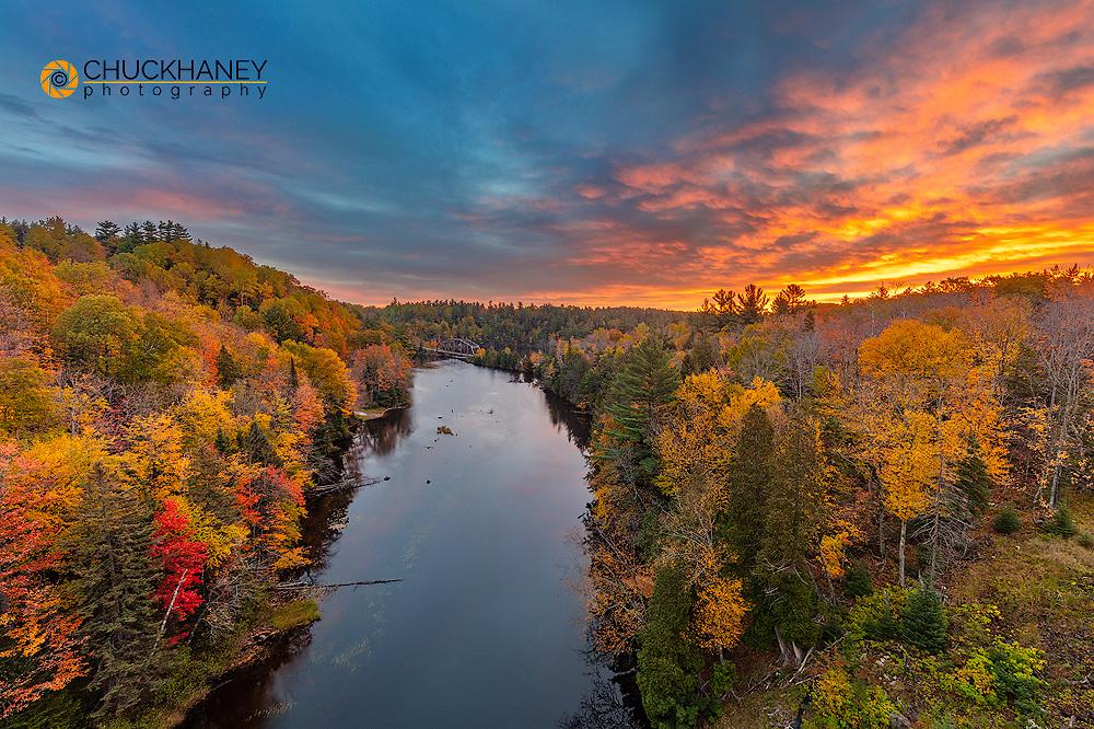 The Dead River at sunrise with autumn color near Marquette, Michigan, USA
