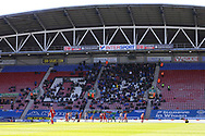a General view of the Cardiff supporters in the stand. EFL Skybet Championship match , Wigan Athletic v Cardiff city at the DW Stadium in Wigan, Lancs on Saturday 22nd April 2017.<br /> pic by Chris Stading, Andrew Orchard sports photography.