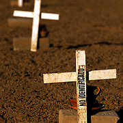 Migrants:.Every year hundreds of migrants die attempting to cross into the United States illegally, the majority from heat stroke and drownings. Over a hundred migrants are buried at a nondescript cemetery located in a undisclosed dirt section of a cemetery in Holtville, Ca near the major crossing point of El Centro, Ca. Most of the bodies were never identified. Please contact Todd Bigelow directly with your licensing requests. PLEASE CONTACT TODD BIGELOW DIRECTLY WITH YOUR LICENSING REQUEST. THANK YOU!