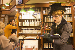 "© Licensed to London News Pictures. 19/11/2013. London, England. Picture: Laura Evelyn as ""Mama Goose/Poet Laureate"" in the Il Papiro shop. ""Once Upon A Christmas"" is a promenade show from the Look Left Look Right theatre company set around Covent Garden's shops, bars and restaurants with the characters on a mission to save Christmas. Photo credit: Bettina Strenske/LNP"