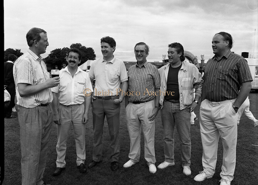 """Guinness Family Day At The Iveagh Gardens. (R83)..1988..02.07.1988..07.02.1988..2nd  July 1988..The family fun day for Guinness employees and their families took place at the Iveagh Gardens today. Top at the bill at the event were """"The Dubliners"""" who treated the crowd to a performance of all their hits. Ireland's penalty hero from Euro 88, Packie Bonner, was on hand to sign autographs for the fans...Members of the organising committee are pictured having a break at the end of a very successful event."""