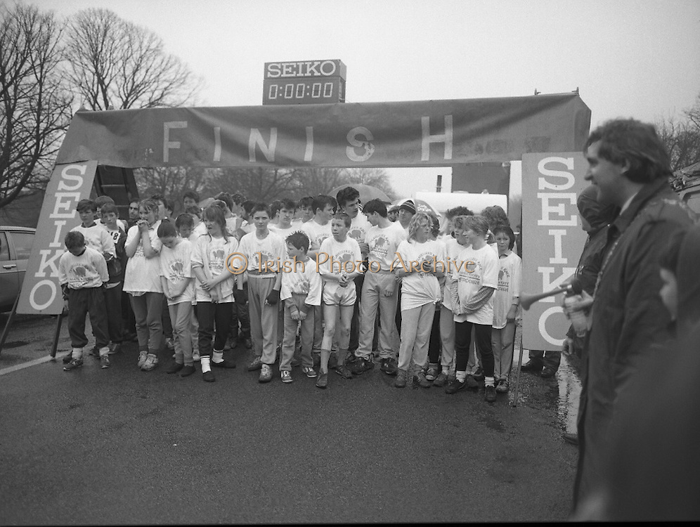 First All-Traveller Mini Marathon.    (R53)..1987..05.04.1987..04.05.1987..5th April 1987..Today saw the running of the first All-Traveller Mini Marathon in aid of Trocaire the World Aid Agency. The race was run over a 10k course in the Phoenix Park, Dublin. Bishop Eamon Casey a patron of the charity was on hand to lend support...Ready,Steady,Go. Image shows Bertie Ahern TD,.Klaxon in hand, about to start the race.