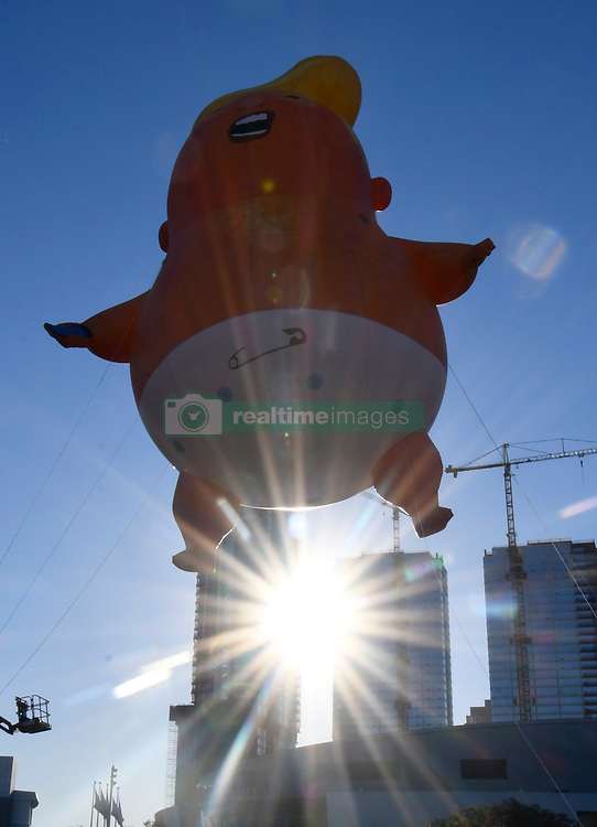 10-19-18. Los Angeles CA.  DOWNTOWN LOS ANGELES .A giant balloon depicting President Donald Trump as an angry baby makes its West Coast debut at Politicon in downtown Los Angeles Friday...The baby Trump balloon will fly over the 110 and 10 freeway interchange outside of the Los Angeles Convention Center starting around 8 a.m. The baby balloon shows Trump in a diaper with a scowl on his face while he holds a cellphone that he tweets from...It's the fourth year for the political convention, which features politicians, pundits, celebrities and journalists from all sides of the political spectrum. Photo by Gene Blevins/LA DailyNews/ZumaPress (Credit Image: © Gene Blevins/ZUMA Wire)