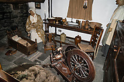 Spinning wheel and home interior mockup at Wordsworth Museum at Dove Cottage, in Grasmere, Cumbria county, England, United Kingdom, Europe. In Dove Cottage in the heart of the remote Lake District, William Wordsworth wrote some of the greatest poetry in the English language and his sister Dorothy kept her 'Grasmere Journal', displayed in the Museum. England Coast to Coast hike day 5 of 14: Grasmere to Ullswater. [This image, commissioned by Wilderness Travel, is not available to any other agency providing group travel in the UK, but may otherwise be licensable from Tom Dempsey – please inquire at PhotoSeek.com.]