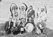 9305-B7384-5. Four Indians and 4 white people at end of Long House, Feast of The First Salmon. Celilo Village. April 16, 1939. Top row: Chief Tommy Thompson on left. Chief Nipo T. Strongheart (1891-1966. acted in Hollywood movies and served as a technical advisor about Native Americans), Henry Thompson, Chief Joe Charley (Yakama) on right.
