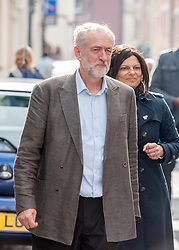 © Licensed to London News Pictures. 15/10/2015. Bristol, UK.  JEREMY CORBYN, leader of the Labour Party, visits shops in Picton Street, Montpelier, Bristol, with Labour's Bristol West MP Thangam Debbonaire (right), following a rally for Labour Party members at the Trinity Centre in Bristol, to highlight and oppose the impact of the Government's changes to voter registration, expected to remove 1 million voters from the electoral roll by the end of the year. Photo credit : Simon Chapman/LNP