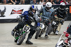Minibike racing at the Flat Out Friday flat track racing on the Dr. Pepper-covered track in the UW-Milwaukee Panther Arena during the Harley-Davidson 115th Anniversary Celebration event. Milwaukee, WI. USA. Friday August 31, 2018. Photography ©2018 Michael Lichter.