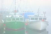 Fishing boats in fog at North Head<br /> Grand Manan Island<br /> New Brunswick<br /> Canada