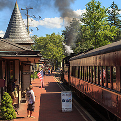 New Hope, PA, USA - June 23, 2012: The New Hope and Ivyland Rail Road passenger train pulls out of the train station.