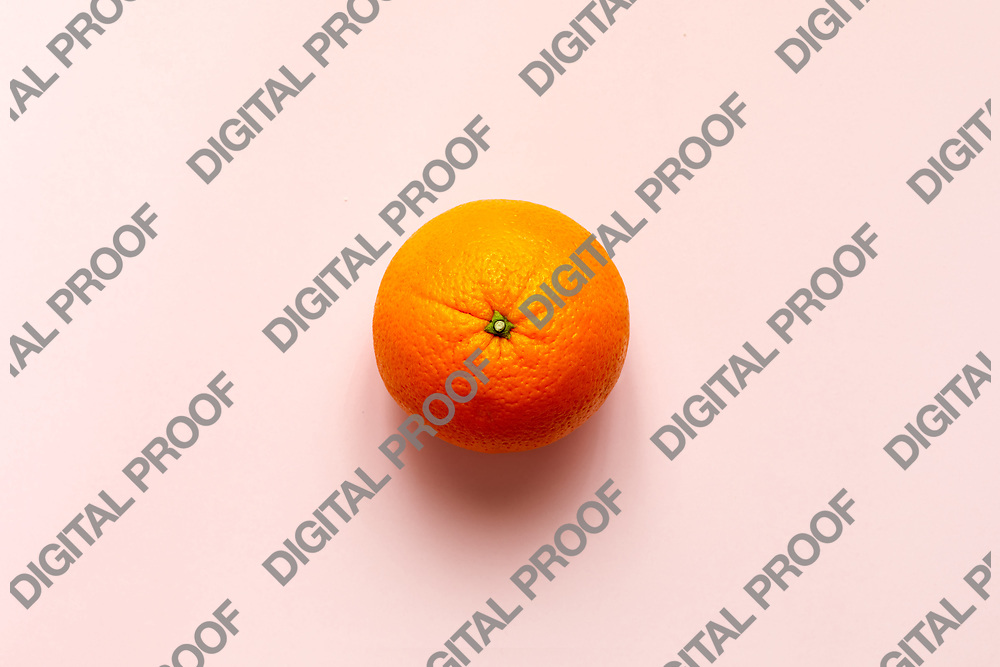 Fresh orange fruit isolated on pink background viewed from above, flatlay style.  Close-up.