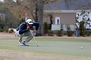 WILMINGTON, NC - MARCH 19: Kent State's Chase Johnson lines up a putt on the Marsh Course first hole. The first round of the 2017 Seahawk Intercollegiate Men's Golf Tournament was held on March 19, 2017, at the Country Club of Landover Nicklaus Course in Wilmington, NC.