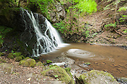 Wideangle view of the lower falls at Fairy Glen on the Black Isle of Scotland.