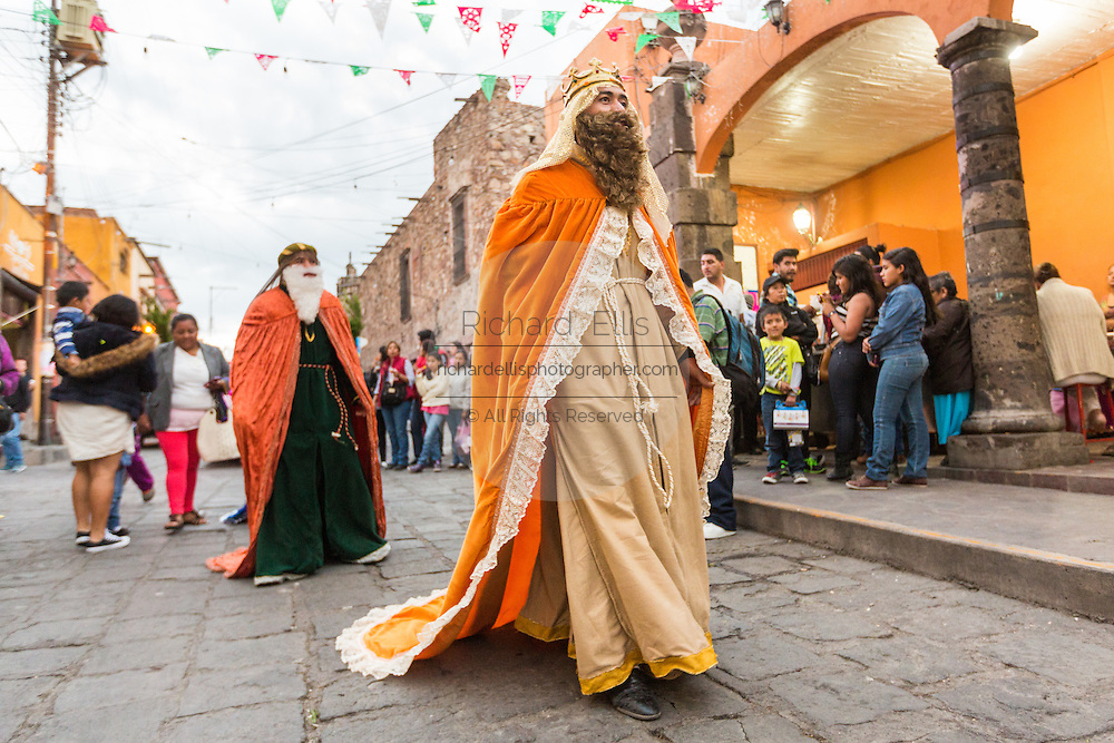 The Three Kings walk to the manger where the baby Jesus doll is waiting during El Dia de Reyes January 6, 2016 in San Miguel de Allende, Mexico. The traditional festival marks the culmination of the twelve days of Christmas and commemorates the three wise men who traveled from afar, bearing gifts for the infant baby Jesus.