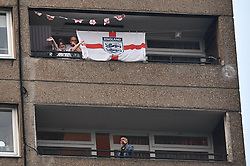 © Licensed to London News Pictures. 23/04/2020. London, UK. Residents of the Trellick Tower in west London take part in Clap For Our Carers by applauding NHS workers, carers and key workers from their windows, balconies and doorsteps. The public have been told they can only leave their homes when absolutely essential, in an attempt to fight the spread of coronavirus COVID-19 disease. Photo credit: Ben Cawthra/LNP