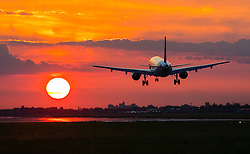 London Heathrow, September 19th 2015. An Airbus A320 lands as the sun sets on London Heathrow's Runway 27R.