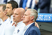 Didier Deschamps, French coach and other french staff singing the anthem at the beginning of Euro Cup Final that opposed Portugal and France, and that the Portuguese won 1-0 on extra-time at Saint Denis stadium in Paris.