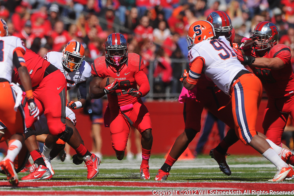 Oct 13, 2012: Rutgers Scarlet Knights running back Jawan Jamison (23) runs through a gap during NCAA Big East college football action between the Rutgers Scarlet Knights and Syracuse Orange at High Point Solutions Stadium in Piscataway, N.J.