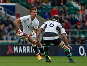 England centre Henry Slade (Exeter Chiefs) dummies to pass during the International Rugby Union match England XV -V- Barbarians at Twickenham Stadium, London, Greater London, England on May  31  2015. (Steve Flynn/Image of Sport)