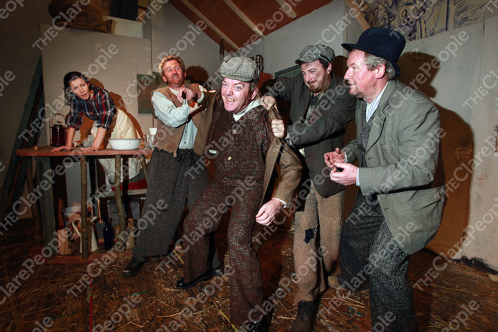 Saoirse Byrne - Pegeen Mike looks on as Derek Crosby-Jimmy, Eric Healy-Philly and Mick Loughnane-Michael James try to hold back Jackie Scanlon - Shawn Keogh during the Ennis Players rehearsals of 'The Playboy of the Western World' on Thursday evening.<br /> Photograph by Yvonne Vaughan