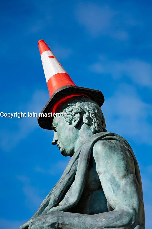 Traffic cone on head of David Hume statue on Royal Mile in Edinburgh, Scotland, UK
