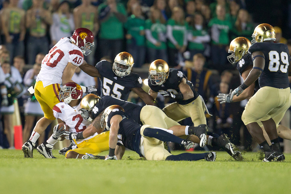 Notre Dame inside linebacker Manti Te'o (#5) tackles USC wide receiver Robert Woods (#2) during first quarter of NCAA football game between Notre Dame and USC.  The USC Trojans defeated the Notre Dame Fighting Irish 31-17 in game at Notre Dame Stadium in South Bend, Indiana.