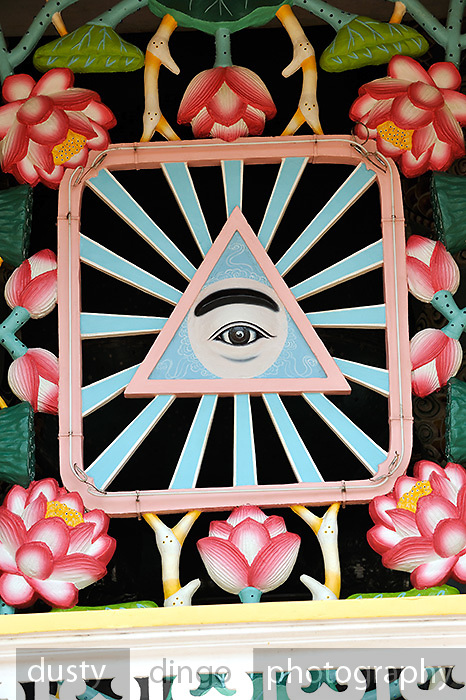 Divine Eye design on wall of Cao Dai temple in Tay Ninh. Cao Dai (full name Dai Dao Tam Ky Pho Do), is the third largest religion in Vietnam, and this is its main temple, the Tay Ninh Holy See, in Tay Ninh, Vietnam
