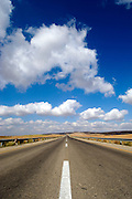 Australian, western New South Wales, Endless road to nowhere running into the horizon blue sky with clouds