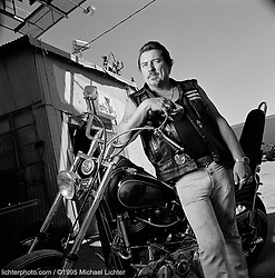Al Klein, Pres. Antelope Valley Sundowners. CA. 1995<br /> <br /> Limited Edition Print from an edition of 50. Photo ©1995 Michael Lichter.<br /> <br /> The Story: Al Klein was president of the Antelope Valley Chapter of the Sundowners Motorcycle Club when I photographed him in his Acton, CA. motorcycle shop.  He may still be the club president but I don't think he still has the shop.  I tried to contact him to send him a print but had no luck; the number has been disconnected and there is no record of the shop.  For a variety of reasons, bikers tend to not leave trails behind them as they move on to a new job or home.  Perhaps, this is why at runs like Sturgis, there is so much excitement on the street as friends greet friends.  It is the one place they know they can find each other.