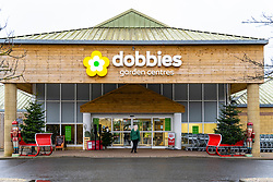 Lasswade, Scotland, UK. 23 December 2020. Dobbies garden centre at Lasswade south of Edinburgh is open but quiet today and will have to close from 26th December during level 4 lockdown . Scottish Government dictates all garden centres and non essential businesses must now close. Iain Masterton/Alamy Live News.