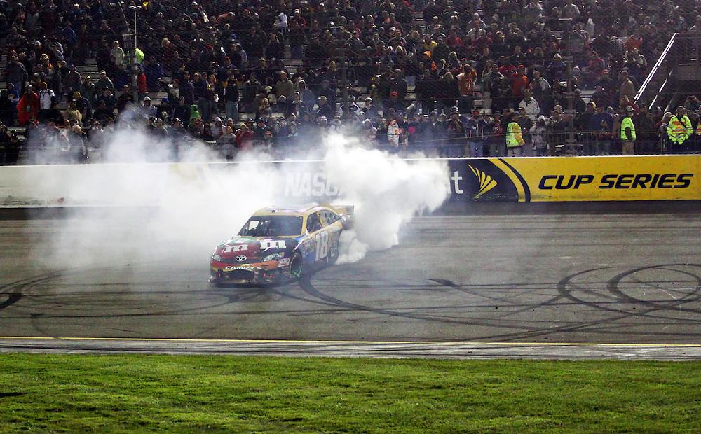 Apr 28, 2012; Richmond, VA, USA; NASCAR Sprint Cup driver Kyle Busch (18) celebrates after winning the Capital City 400 at Richmond International Raceway. Mandatory Credit: Peter Casey-US PRESSWIRE.