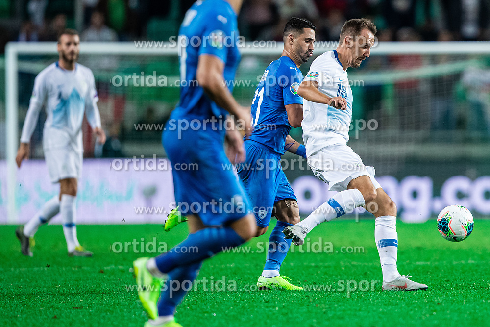 Denis Popovic of Slovenia and Beram Kayal of Israel during the 2020 UEFA European Championships group G qualifying match between Slovenia and Israel at SRC Stozice on September 9, 2019 in Ljubljana, Slovenia. Photo by Grega Valancic / Sportida