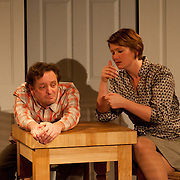 Chris Curtis (Beane) and Christine Penney (Joan), in a scene from the Harbor Light Stage production of Love Song, a play by John Kolvebnbach, directed by Kent Stephens at The Music Hall Loft in Portsmouth, NH, May, 2011