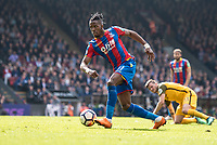 LONDON, ENGLAND - APRIL 14: Wilfried Zaha (11) of Crystal Palace during the Premier League match between Crystal Palace and Brighton and Hove Albion at Selhurst Park on April 14, 2018 in London, England. (Photo by MB Media/Getty Images)