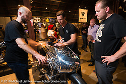 Max Hazan gives Alan Stulberg (Revival Cycles) and Casey Ketterhagen (Harley-Davidson Design studio) a tour of his antique that he just rebuilt on Saturday at the Handbuilt Motorcycle Show. Austin, TX. April 11, 2015.  Photography ©2015 Michael Lichter.
