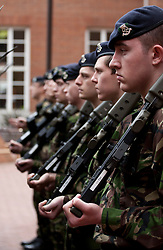 © licensed to London News Pictures. London, UK 10/03/2012. London's Territorial Army soldiers, many of whom have taken part in overseas operations in Iraq and Afghanistan standing outside Kensington Town Hall after marching on Kensington High Street this noon (10/03/12). Photo credit: Tolga Akmen/LNP