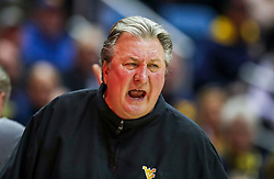 Jan 14, 2020; Morgantown, West Virginia, USA; West Virginia Mountaineers head coach Bob Huggins yells from the bench during the second half against the TCU Horned Frogs at WVU Coliseum. Mandatory Credit: Ben Queen-USA TODAY Sports