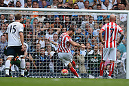Marko Arnautovic of Stoke City scores his sides first goal of the game to make it 2-1 from a penalty. Barclays Premier league match, Tottenham Hotspur v Stoke city at White Hart Lane in London on Saturday 15th August 2015.<br /> pic by John Patrick Fletcher, Andrew Orchard sports photography.