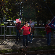 RALEIGH, NC - NOVEMBER 14: A woman waves a flag as supporters of President Donald Trump rally to protest results from the 2020 Presidential election that show a clear victory for President-Elect Joe Biden near the state house in Raleigh, NC on November 14, 2020. Supporters of President Trump are rallying across the country to protest what the the President is calling rampant election fraud perpetrated by the Democratic Party to steal the election for Joe Biden even though there is little evidence to support their claims.  (Photo by Logan Cyrus for AFP)