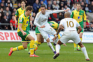 Swansea's Gylfi Sigurdsson (c) has his shot blocked by Norwich's Timm Klose (orange boots). Barclays Premier league match, Swansea city v Norwich city at the Liberty Stadium in Swansea, South Wales on Saturday 5th March 2016.<br /> pic by  Carl Robertson, Andrew Orchard sports photography.