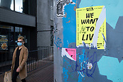As numbers of Covid-19 cases in Birmingham have dramatically risen in the past weeks, increased lockdown measures have been announced for Birmingham and other areas of the West Midlands, a man weearing a face mask passes an Extinction Rebellion poster which reads 'We Want To Live' on 29th September 2020 in Birmingham, United Kingdom. With the rule of six also being implemented the Birmingham area has now be escalated to an area of national intervention, with a ban on people socialising with people outside their own household, unless they are from the same support bubble.