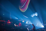 Planetarium, a series of songs composed by Bryce Dessner, Sufjian Stevens, and Nico Muhly at the Brooklyn Academy of Music (BAM). In the front, from left to right, Nico Muhly, Sufjian Stevens and Bryce Dessner. Lighting design by Deborah Johnson.