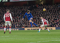 Football - 2017 / 2018 Premier League - Arsenal vs. Chelsea<br /> <br /> Marcos Alonso (Chelsea FC)  with a header from distance that forces a save from Petr Cech (Arsenal FC) at The Emirates.<br /> <br /> COLORSPORT/DANIEL BEARHAM