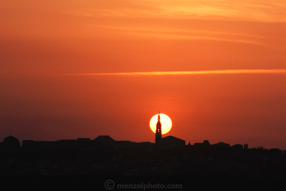 Briones village church spire silhouetted by the setting sun, La Rioja, Spain.