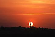 Briones village church spire silhouetted by the setting sun, La Rioja, Spain.